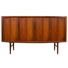 Omann Jun - Rosewood Sideboard | From a unique collection of antique and modern sideboards at http://www.1stdibs.com/furniture/storage-case-pieces/sideboards/ 46.5 in. (118 cm) WIDTH:	6 ft. 6.8 in. (200 cm) DEPTH:18.5 in. (47 cm) From Almond-Hartzog, SF.