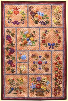 2005 - Blije blommen. Deze quilt is voor mij de eerste kennismaking met intensieve applicatie. De verrassing zit er in dat de achtergrond een gewolkte licht oranje is.