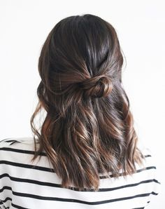 Messy Half Bun - This simple and quick hairstyle is a great pick-me-up for those on the go this holiday weekend. 8 Low-Key Hairstyles for the Fourth of July via @byrdiebeauty