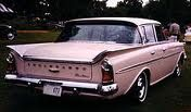 Pink Ford Rambler- My Aunt Hazel had a blue one.  The back window rolled down.