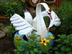 How to cut a tire and make it into a garden pot.wmv - YouTube   There are many other ideas (pictures) for uses of tires - love this swan!