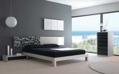 Bedroom with black and white bed grey walls and bedroom furniture