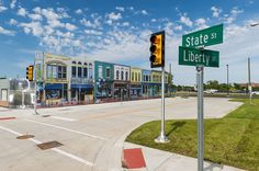 An intersection at MCity, the fake town that was recently built in Ann Arbor to test driverless cars and other technologies. Photo via University of Michigan Mobility Transformation Center....