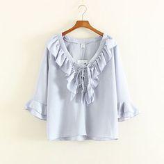 Buy Mushi Ruffle Trim Lace Up Front Long Sleeve Chiffon Blouse at YesStyle.com…
