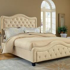 "Upholstered bed with button tufting and nailhead trim.    Product: BedConstruction Material: Polyester and woodColor: BuckwheatFeatures:   Nailhead trimButton-tuftingSoft and luxurious upholsterySlats included Dimensions:  Queen: 58"" H x 64.5"" W x 89"" D  King: 58"" H x 80.5"" W x 89"" DNote: Mattress and linens are not included and are pictured for illustration purposes only. Box spring not required."