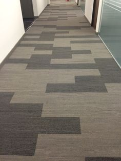 Urban Retreat carpet tile planks installed into corridor available from Creed-Miles.