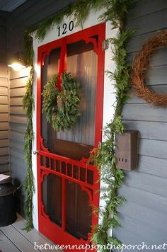A Festive Country Southern welcome!!! Bebe'!!! Love this welcoming front porch all decorated with balsalm greens and red velvet ribbon!!!