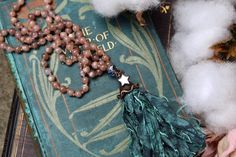 A stunning beaded mala style necklace for a mermaid! Pretty sunstone beads have been knotted onto hemp and adorned with a sea green taffeta tassel and electroformed mirror star charm ☆ To see more follow me on Instagram @byamillia or visit www.byamillia.com ✯ #tasselnecklace #beadednecklace #malaneckalce #sunstone #mermaidjewelry #oceanart #oceaninspired