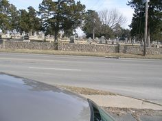 Cemetery in Independence Kansas - I could spend an entire day perusing this cemetery - it's a mile long and has the stone fence running the entire length