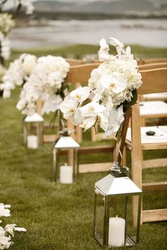 Lanterns/flowers on aisle, or could replace lanterns with vases w/ candles or something like that