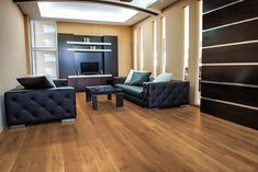"""Time for a Mid-century modern living room aesthetic change? Look no further than our Ellington European Oak Hardwood Floors in Harvest Moon. This medium hardwood floor has a modern, clean look obtained by relying on the wood grains' natural complexity. It's engineered hardwood, comes in 8 5/8"""" planks, and starts at $8.99 SQ FT."""