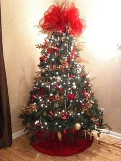 Red And Gold Christmas Tree With Huge Bow Pretty