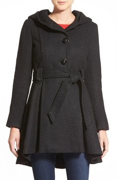 Free shipping and returns on Steve Madden Belted Hooded Skirted Coat at Nordstrom.com. Lush texture enriches a pretty winter coat topped with a generous hood and nipped with a tie belt. The silhouette flares to a full high/low skirt for a flirtatiously feminine look and glossy, domed buttons complete the style.