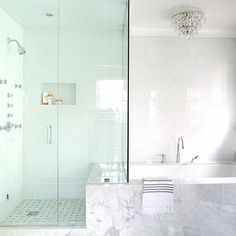 White Glass Tub Backsplash Tiles Extend Into Shower