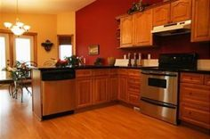 Red Kitchen Wall with Light Oak Cabinets