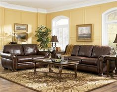 dark-brown-leather-sofa-classic-traditional-living-room-paint-colors-with-brown-furniture-cream-wall-color-abstract-painting-hardwood