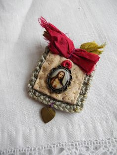 Crochet and hand dyed fabric with Jesus of Mercy charm - Brooch