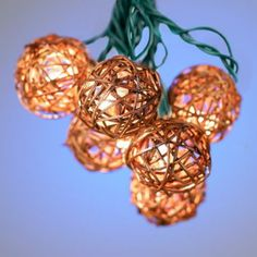 We love the organic look of outdoor string lights with rattan accents.