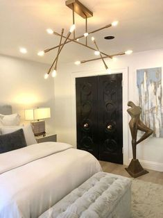 Modern Light Fixtures Feminine bedroom with sculpture and modern light fixture, designed by Rozita Nazarian, Pasadena Showcase House. Modern Bedroom Lighting, Bedroom Decor Lights, Bedroom Light Fixtures, Bedroom Ceiling, Modern Light Fixtures, Rustic Lighting, Contemporary Bedroom, Modern Bedrooms, Bedroom With Chandelier