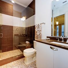 Stunning European shower with detailed tile work! Love the large vanity mirror as well!   www.franksglass.com