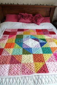 Check out DebbieRedman's Large Geometric Rainbow Granny Square Blanket. More pics and info via the link to Ravelry.