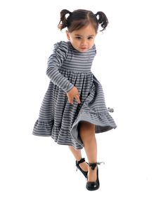 A modern take on a fashion maven's favorite, this striped dress has big personality with sweet stripes, ruched sleeves and a little ruffed hem.95% cotton / 5% spandexMachine washImported
