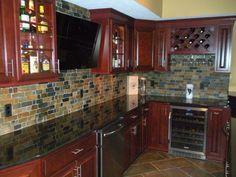 kitchen-backsplash-cherry-cabinets-black-counter