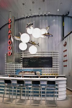 volume & space with regards to branding & decor Seafood Shop, Seafood Restaurant, Cafe Restaurant, Cafe Design, Store Design, Restaurant Interior Design, Cafe Interior, Restaurant Lighting, Fish Design