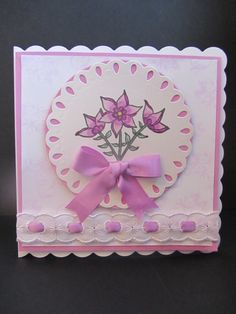 This card shows how a basic flower stamp can be turned into a really pretty card by using ribbon and card in a co-ordinating colour. The lace adds a touch of luxury and turns the card into something unique and special. The flower stamp is another of my own designs and is available from: http://stamp-press.com/designers/dette-s/a7-flower-stems-by-dette-s-detail