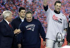 New England Patriots quarterback Tom Brady, right, holds the AFC championship trophy beside team owner Robert Kraft, left, honorary captain Tedy Bruschi, second from left, and head coach Bill Belichick after the AFC championship NFL football game, Sunday, Jan. 22, 2017, in Foxborough, Mass. The New England Patriots defeated the the Pittsburgh Steelers 36-17 to advance to the Super Bowl.(AP Photo/Matt Slocum)