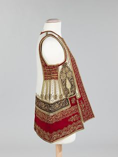 The ornate decoration on this sleeveless jacket was created using a wide variety of materials. The wool foundation, as well as the applied layers of felt, gold cord and spangles, have retained their freshness Greek Traditional Dress, Traditional Outfits, Albanian Culture, Dress Neck Designs, Wedding Costumes, Folk Embroidery, Greek Wedding, Folk Costume, Historical Costume