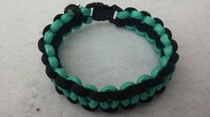 Check out this item in my Etsy shop https://www.etsy.com/listing/229280618/teal-and-black-paracord-bracelet