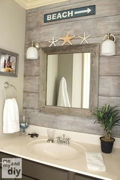 "beach theme bathroom - love the ""drift wood"" behind the mirror"