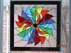 Colorful glass pin wheel on a swirly clear background bordered in black mirrored glass measuring 23 x 23 One of my favorite Stained Glass Quilt, Stained Glass Flowers, Stained Glass Panels, Stained Glass Projects, Stained Glass Patterns, Rainbow Glass, Rainbow Art, Mosaic Art, Mosaic Glass