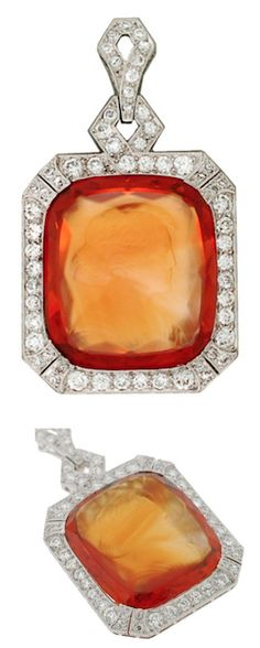 *Art Deco Diamond & Carved Citrine Cameo Platinum Pendant,  A stunning carved citrine cameo pendant from the Art Deco (1920) era! This fantastic piece depicts a large, rectangular-shaped citrine stone which is surrounded by sparkling diamonds. The citrine, which is vibrant in color with hues of orange, yellow, and brown, is bezel set in a platinum setting. Circa 1920.