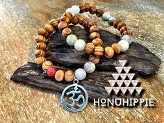 "Beaded yoga ""om"" symbol bracelet, boho hippie jewelry by HonuHippie on Etsy https://www.etsy.com/listing/260063055/beaded-yoga-om-symbol-bracelet-boho"