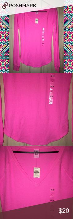 Victoria's Secret PINK V-Neck Thermal Long Sleeve Size: extra Small (XS), but seems to fit bigger could very well fit a small (s) Brand: Victoria's Secret pink  Condition: NEW with tab  Details: this is a very vibrant hot pink. V-neck waffle style Thermal long sleeve top. Perfect for cold nights. And great to layer as well. Retail $24.50. Has never been tried on or worn does have oringaly price and size tags. PINK Victoria's Secret Tops Tees - Long Sleeve