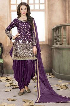 COLOR : Purple FABRIC : Top - Taffeta Silk, Bottom & Inner - Santoon, Dupatta - Net WORK : Zari & Silk Thread Embroidery, Heavy Glass Mirror Work, Lace BorderOCCASION : Party Wear, Festival, Reception, Wedding READY-TO-WEAR : No STITCHING : Available as semi-stitched fabric, can be stitched using standard size option (+ $20). Note: There might be a slight color variation due to lighting and flash used during photoshoot. The bright shade seen is the best closer view of ...