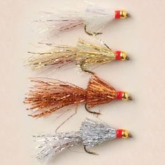Empie's Deadly Shiner - I 've fished these little flash-type patterns since I was a kid (Bob). Consider these a go-to searching pattern, especially at mid-day when there's no bug activity. Fish with fast strips, use at least 5X tippet, they'll try to jerk the rod out of your hand when they hit it. (1)Pearl, (2)Gold, (3)Copper, (4)Silver - Size: 8