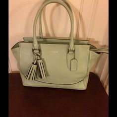 """Coach Mint Satchel Authentic Coach Satchel, mint colored, excellent condition, zip closure, dimensions - length-15""""' height-9"""", width-4"""". Inside one side large zipper pocket; other side large zipper pocket & two smaller pockets for cell phone, eye glasses, etc. Outside back zipper pocket, feeted bottom. Coach Bags Satchels"""