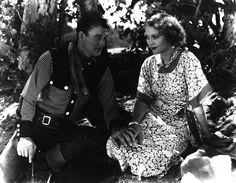 John Wayne as Chris Morell and Sheila Terry as Clara Moore in ''  'Neath Arizona Skies'' 1934''