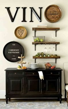 Our vignetto shelves make for a great bar in a dining room, especially when paired with a console table.