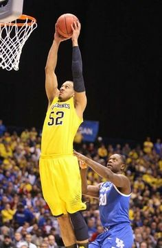 Michigan's Jordan Morgan scores against Kentucky forward Julius Randle during first half action in the NCAA Midwest Regional Tournament.