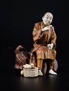 Okimono en forme de paysan fumant ivoire et bois Japon