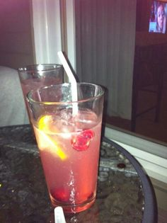 Wine spritzer with red moscato, sweet white wine, lemon limeade and seltzer with muddled fresh cherries and squeezed lemon.