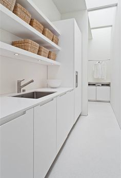 Color: 25 Fabulous All-White Rooms This minimalist kitchen is immaculate.This minimalist kitchen is immaculate. White Laundry Rooms, Modern Laundry Rooms, Laundry In Bathroom, Small Laundry, Minimalist Kitchen, Minimalist Interior, Modern Minimalist, Minimalist House, Minimalist Bedroom