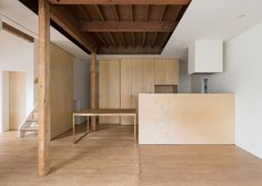 Family home converted into a stripped-back dwelling for empty nesters.