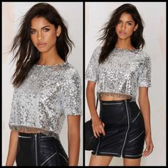 NWT nasty gal silver sequin fringe top Flash it up and bring it back. The Flash Back Top features allover silver sequin detailing, gunmetal beaded fringe, zipper at back, and cropped silhouette. Looks killer with a black leather mini skirt and heels to match. By Glamorous. *Polyester *Runs true to size Nasty Gal Tops Crop Tops