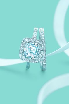 Tiffany Legacy diamond engagement ring with a matching diamond wedding band. Omg.