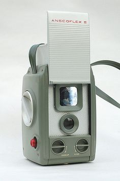 If you have an interest in classic cameras, you're probably familiar with this one. Designed by Raymond Loewy and made of metal, the Anscoflex features a protective front panel which, when raised, opens the viewfinder cover at the top via a clever mechanical linkage. The difference between this model and the original Anscoflex is that this one has the addition of a close-up lens and yellow filter, which swing into place by turning the knobs beneath the lens.  Made by Ansco (New York) c1954…